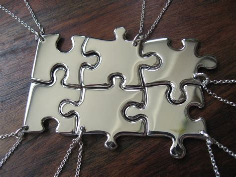 six silver puzzle pendant necklaces