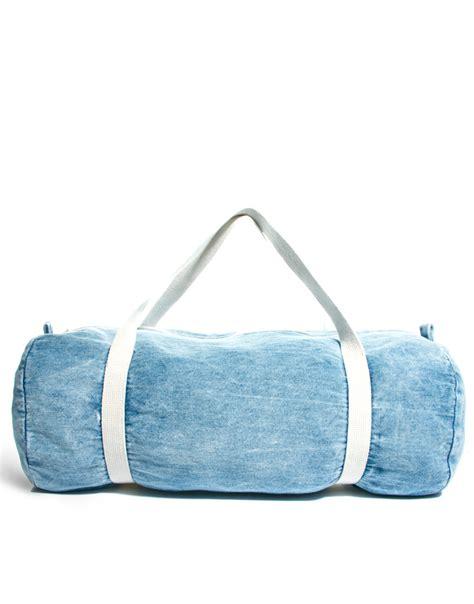 american apparel denim duffle bag in blue