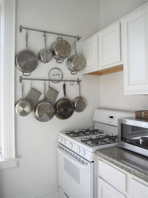 Hang Pots And Pans In Small Kitchen T H E O R D E R O B S E S S E D Hanging Pots Pans Storage