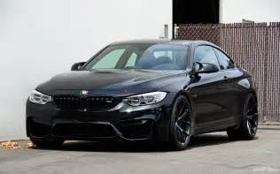 black sapphire bmw m4 with matte black hre wheels