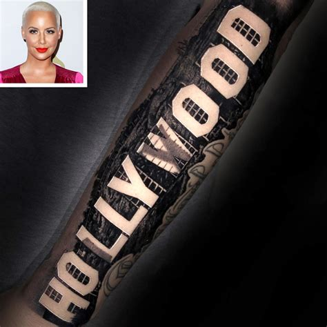 amber rose leg tattoo gets sign tattooed across forearm