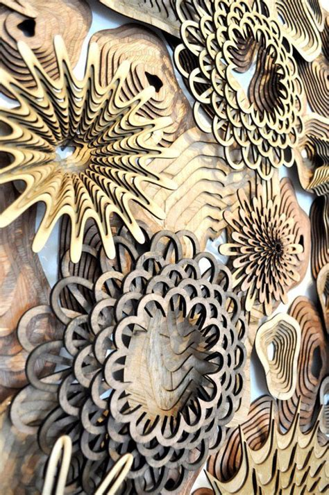 sculptured dimensional hair cut artist s intricate laser cut sculptures mimic coral reef