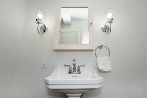 how to choose the best bathroom lighting fixtures elliott spour house how to choose the right lighting for your bathroom remodel