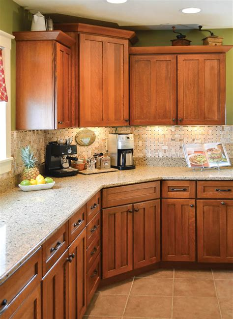 countertop colors for light oak cabinets pale green walls and under cabinet lighting add character