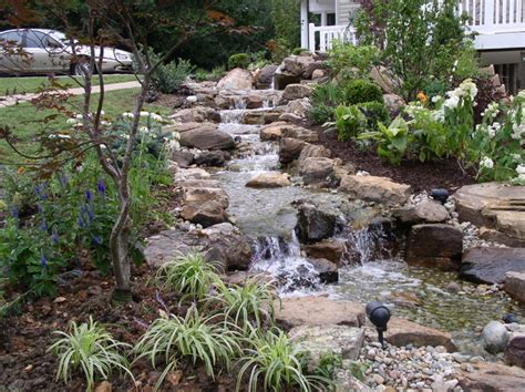 backyard stream ideas hillside waterfall tropical landscape kansas city