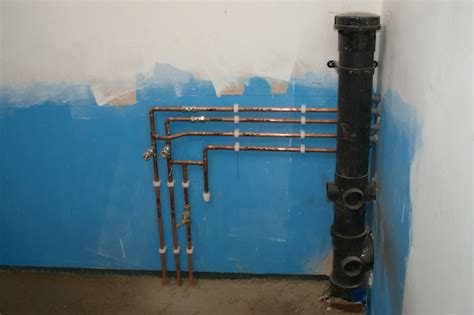 sub stack and plumbing in utility room