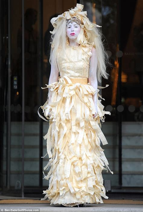 Dress Gaga gaga braves the worst to hit britain in a decade in a dress made of crepe paper