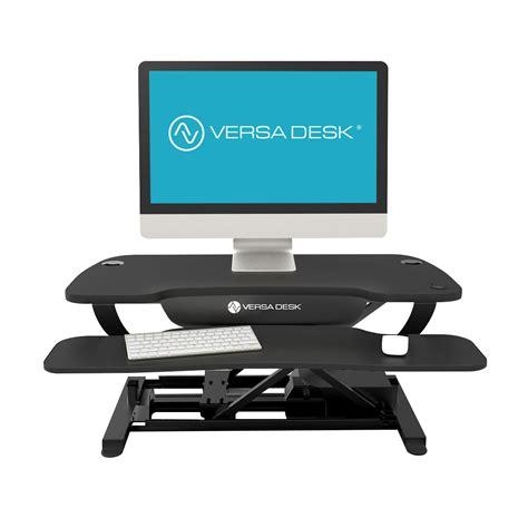 powered by desk com versadesk electric push button adjustable height desk