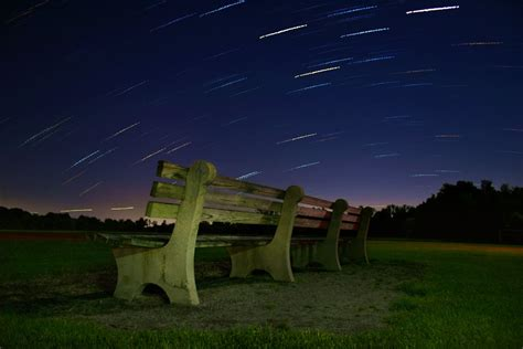 field bench bench in field with star trails by a12524 on deviantart