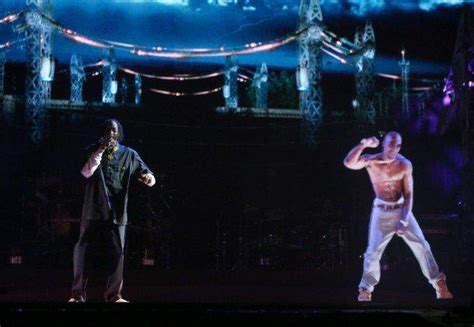 tupac at coachella rapper comes alive via hologram to tupac shakur to tour with dr dre and snoop dogg via