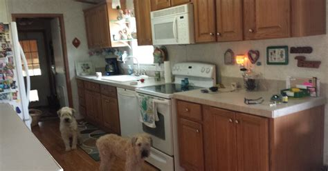 painting pressboard kitchen cabinets update pressboard cabinets hometalk
