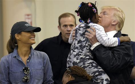 donald trump holding little boy kissing kids and taking selfies upbeat trump visits