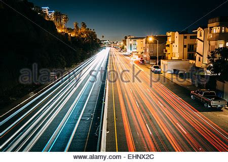 Traffic On Pch - traffic on pacific coast highway at night in santa monica stock photo royalty free