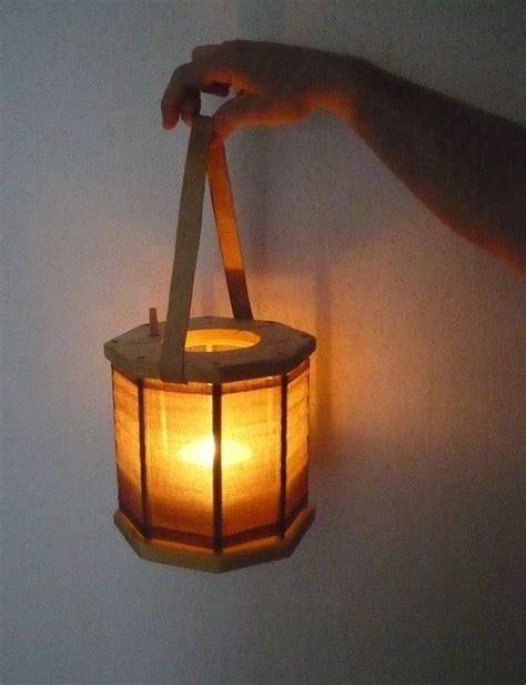 construction paper tree lit with tea light wood lantern make it collapsible and toss in an electric tea light outdoors