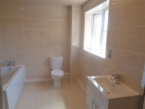 on suite bathrooms ensuite with straight bath and large shower enclosure
