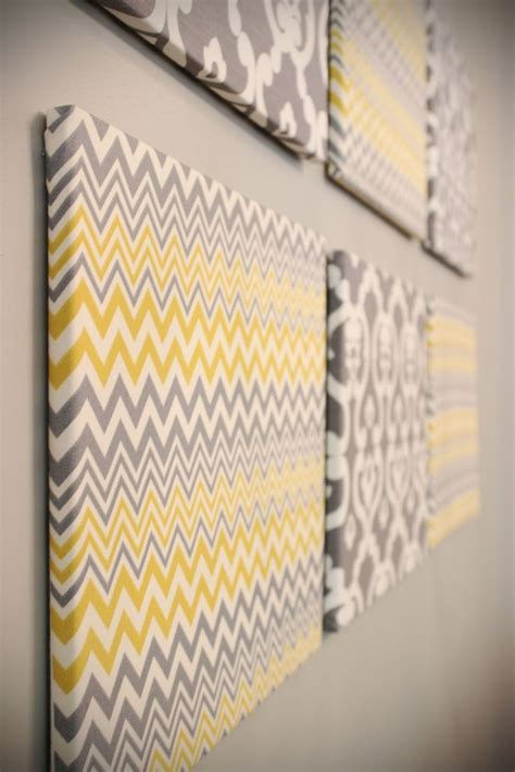 gray wall decor blank canvases with fabric stapled them for a yellow and gray bathroom d i