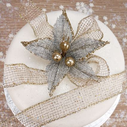 grey hessian poinsettia with bow and gold glitter mesh ribbon