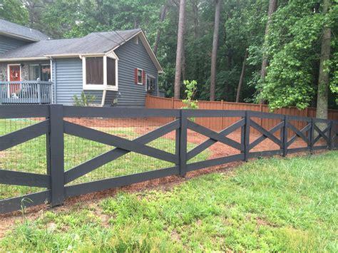 crossbuck wood fence painted black backyard backyard