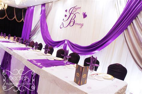 An extra long backdrop, with royal purple and silver satin