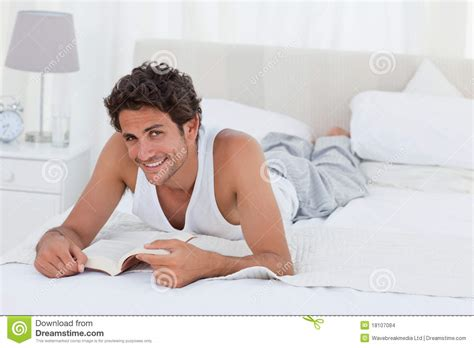 bed man man reading a book on his bed stock images image 18107084