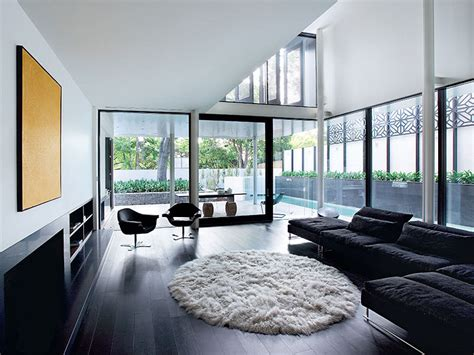 black wood flooring modern home with black sofa and wood flooring