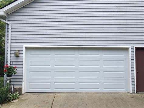 Premier Garage Door 16 X 7 C H I Garage Door Model 4250 Panel Color White Installed In Brighton Mi