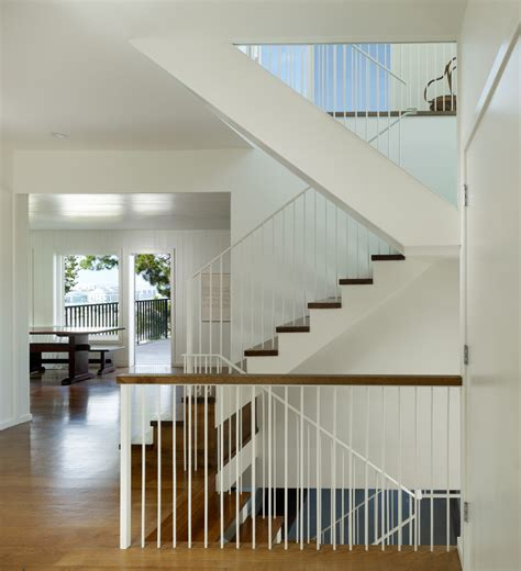 contemporary banister banisters staircase transitional with open floor plan