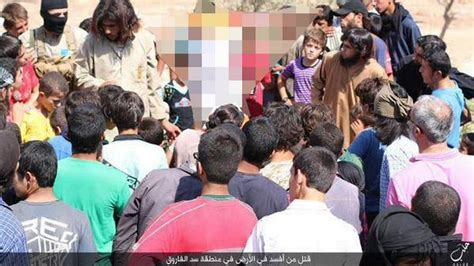 isis sliced off syrian boys fingertips in failed bid to isis thugs force children to watch as executioners behead