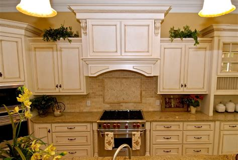 white kitchen cabinets with chocolate glaze antique white with chocolate glaze kitchen traditional