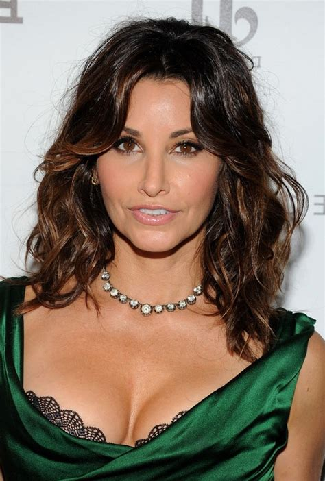 medium curly hairstyles styles weekly gina gershon layered medium wavy hairstyle for women over