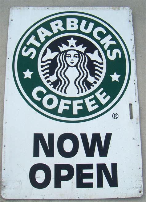 is starbucks open starbucks coffee now open white metal sign green split