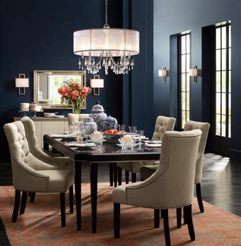 Dining Room Chandeliers With Shades by A Crystal Chandelier With A Silver Silk Shade Adds Sparkle