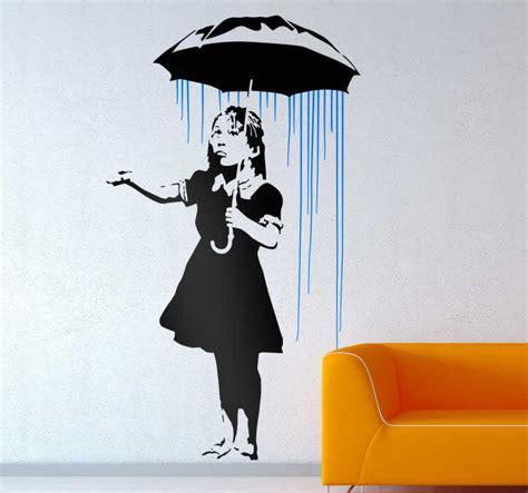 sticker mural graffiti banksy fille sous la pluie