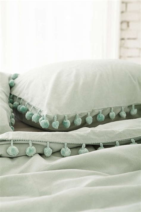 pom pom bedding magical thinking pom fringe duvet cover urban outfitters