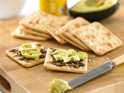 avocado on crackers with vegemite australian avocados