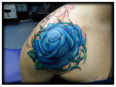 blue rose tattoo and piercing 37 exclusive blue tattoos and designs