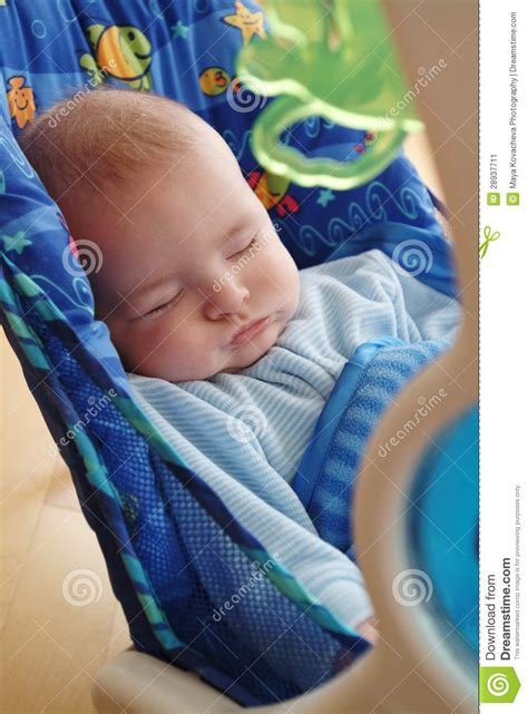 infants sleeping in swings sleeping baby stock image image 28937711
