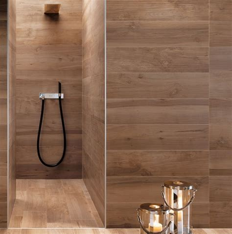 faux wood planks get a trending stone wall look shower with wood grain tile design trend faux bois a