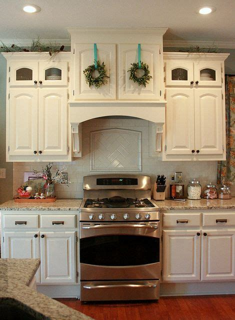 range with cabinet above tiny boxwood wreaths above the stove chris carleton at