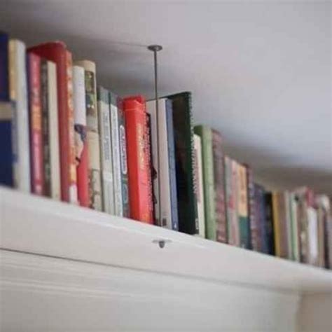 beautiful overhead bookcases space saving shelving ideas 19 foolproof ways to make a small space feel so much