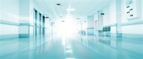 hospital background checks rays of light in the corridor of the hospital