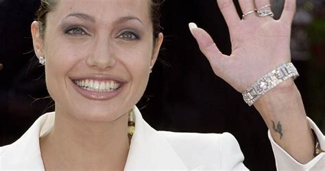 angelina jolie wrist tattoo list of all tattoos and their meanings
