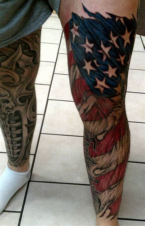 american flag tattoo on lower american flag on left leg