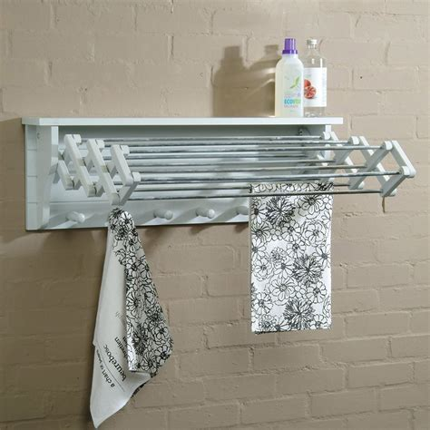 extendable timber clothes dryer wall mounted  blue door