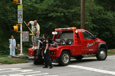 file 2010 05 30 tow truck driver broom to officer jpg