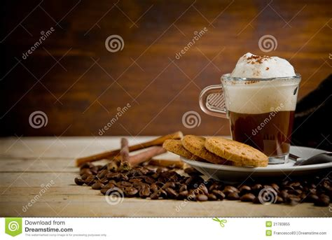 Cappucino Coffee Bean cappuccino on coffee beans royalty free stock photo