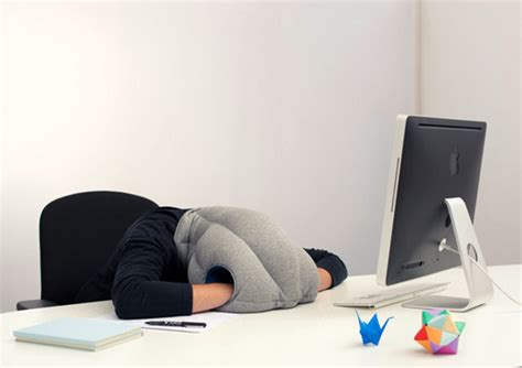 the ostrich pillow lets you nap anywhere look like a tool