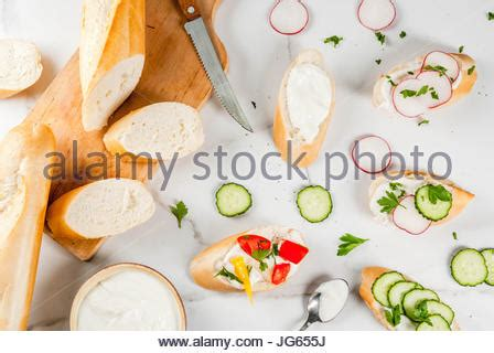 Hummus And Radish Detox Diet by Healthy Vegan Food Sandwiches And Fresh Vegetables On