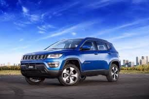 2017 jeep compass poses for the in all trim levels