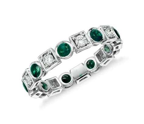 emerald and eternity ring in 18k white gold